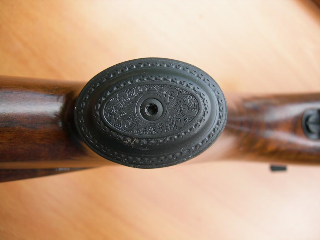 Engraved grip cap on .257 Roberts rifle
