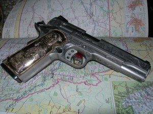 Engraved Smith and Wesson 1911 with gold grips.